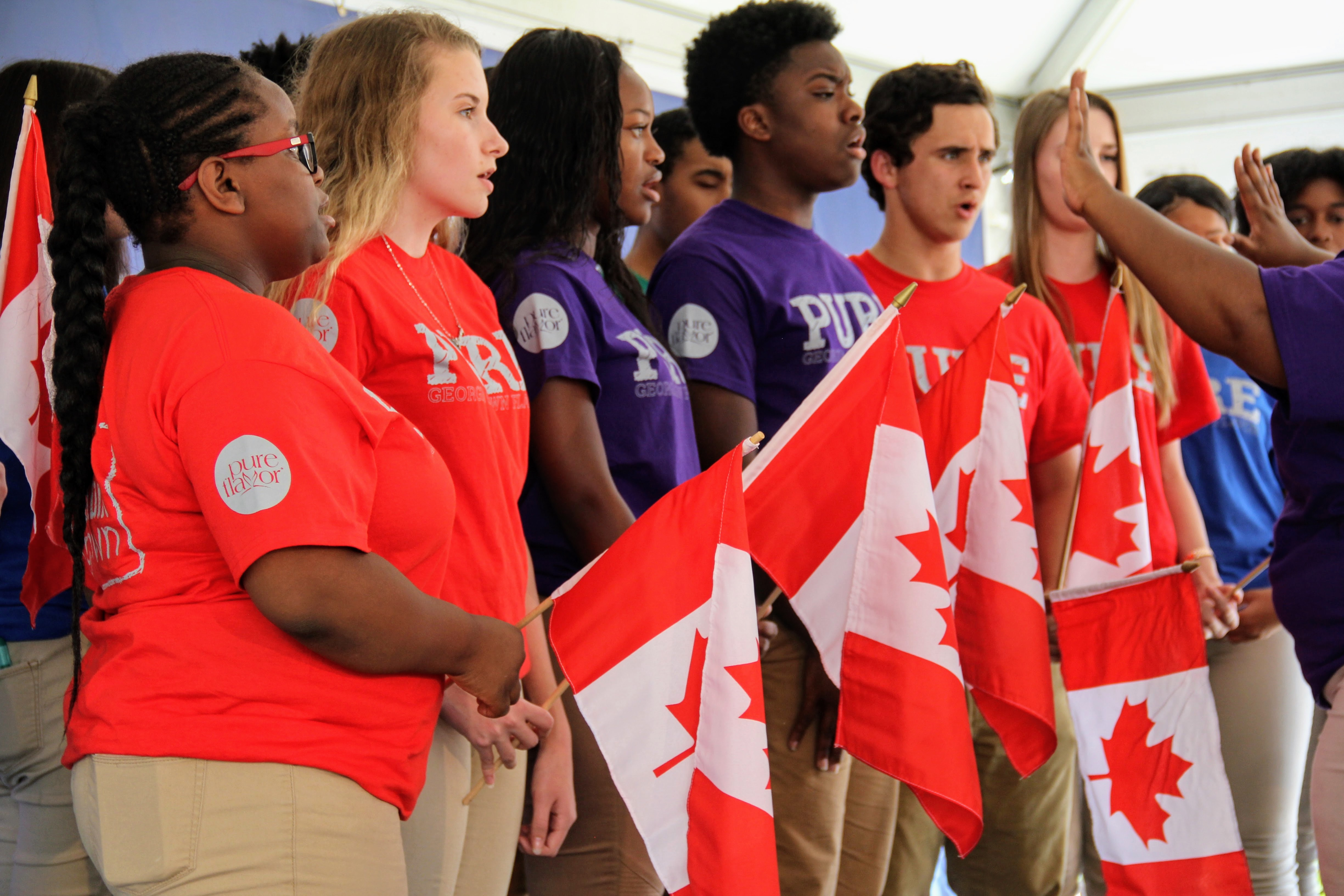 Middle and high school students from Peach County sing a beautiful rendition of the Canadian National Anthem at the Pure Flavor Ground Breaking Ceremony